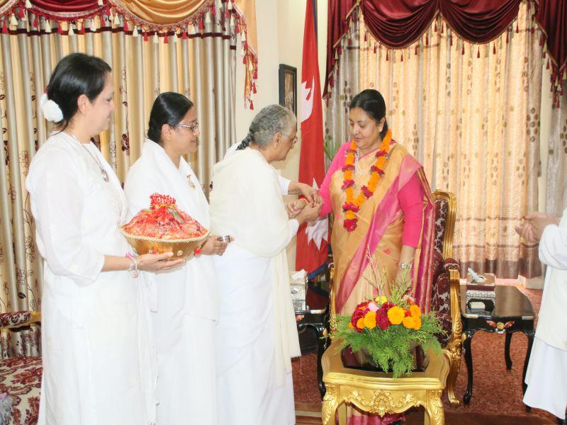 Hon'ble President of Nepal Ms. Bidhya Devi Bhandari tying rakhi by Rajyogini Raj Didi