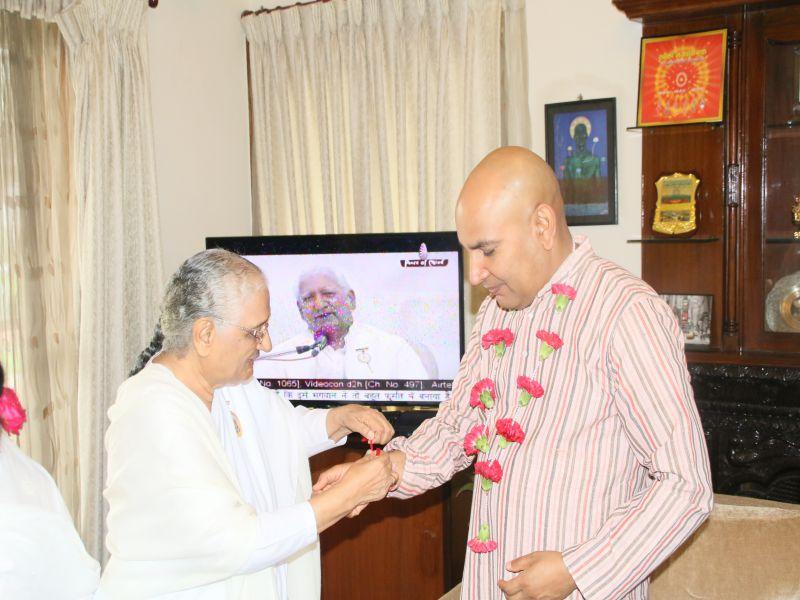 Raj didi tying rakhi to Inpector General Mr. Prakash Aryal